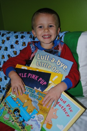 hristie's son Joel (5) has a hard time choosing his favorite Imagination Library book. He is pictured here with some of his all time favorites.