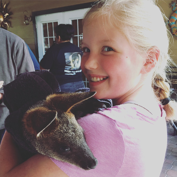 a girl and her wallaby