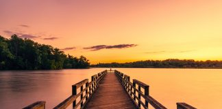 pier overlooking lake at sunset